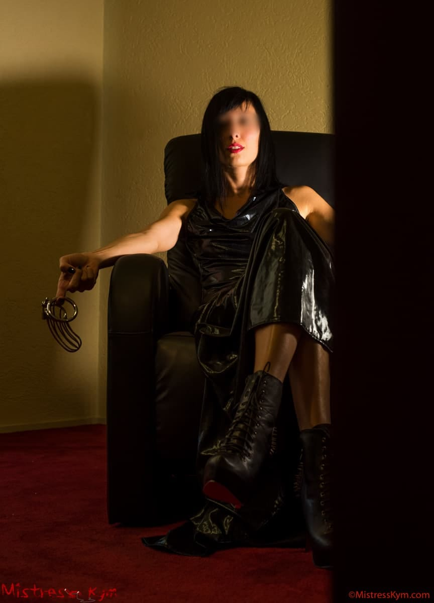 mistress kym is waiting for her slave showing his chastity belt and keeping the key on her