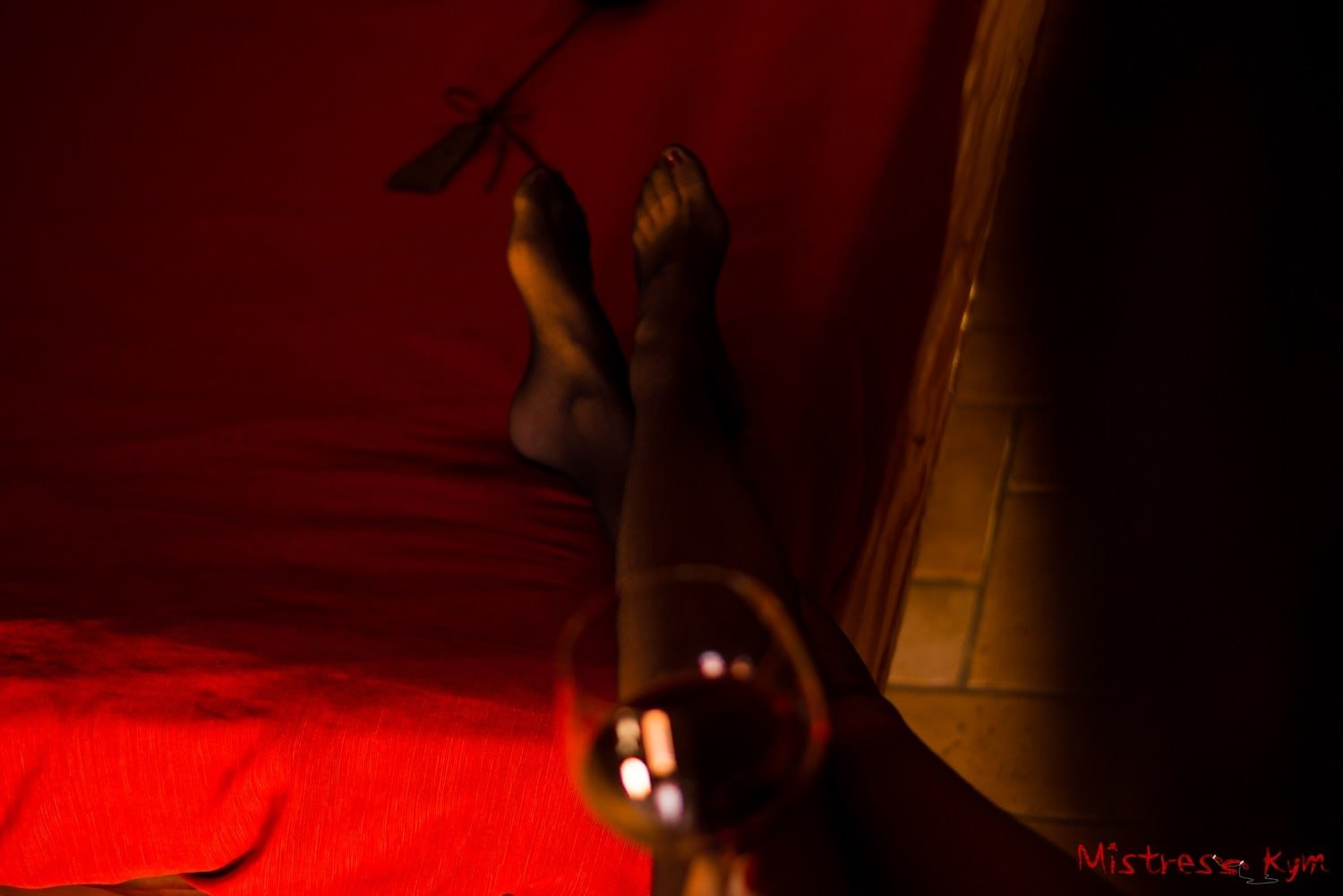MistressKym stocking and red wine